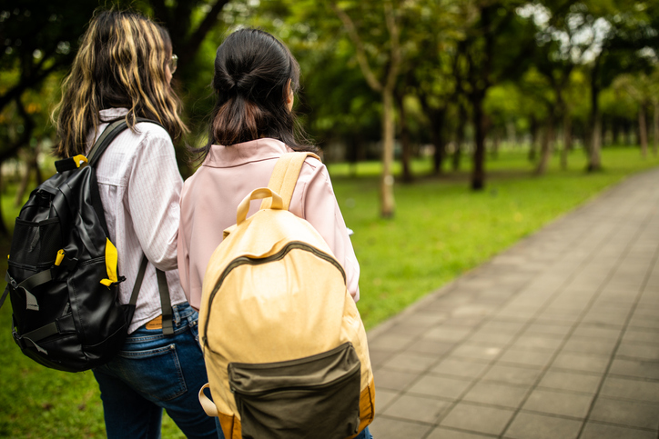 Two girl classmates walking together.