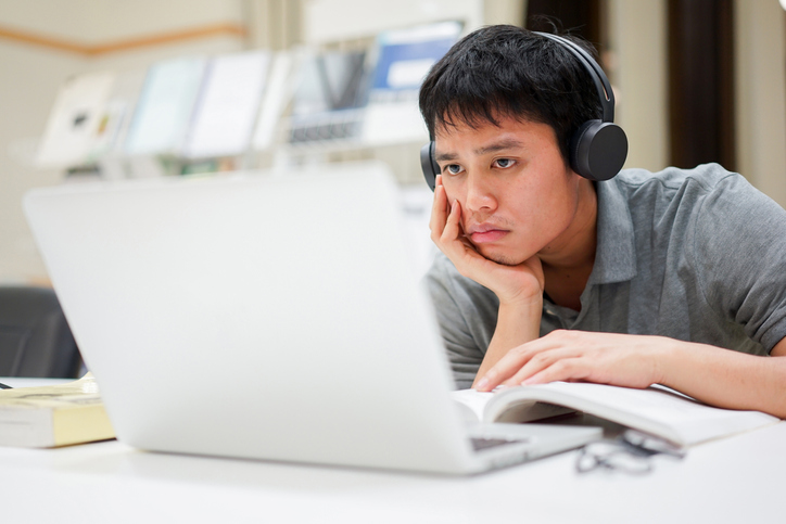 young boy using computer.