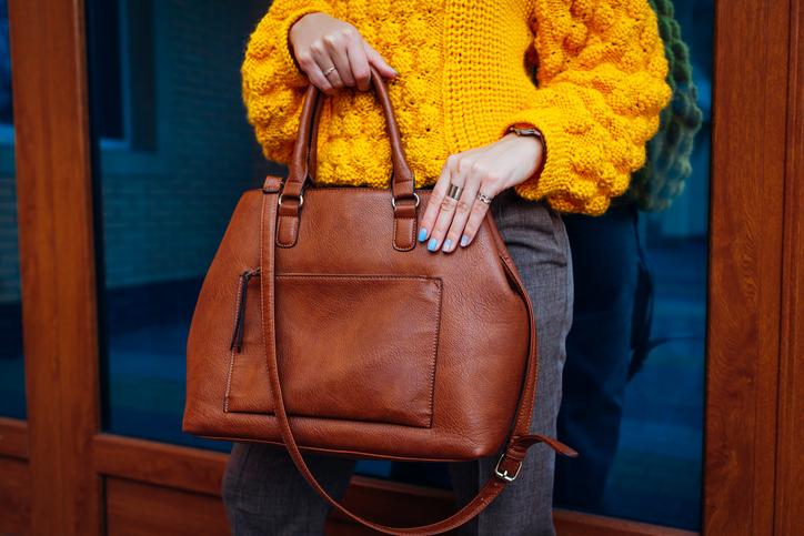 Woman holding handbag.