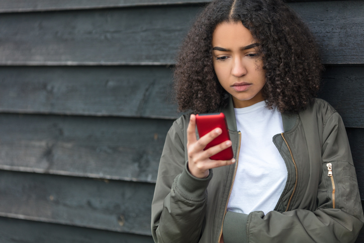 Young girl using phone