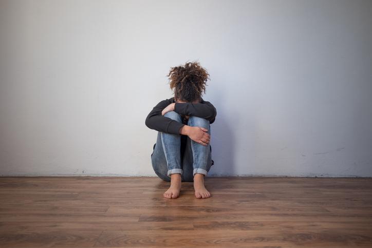 Girl holding her head in her hands