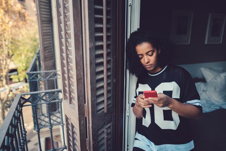 Young teenage girl using phone.